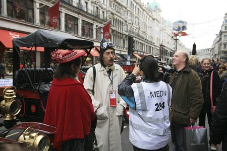 london to brighton veteran car run: London, UK - November 06, 2010: Participants have interview with media in Londons Regent Street on the day before the London to Brighton Veteran Run.
