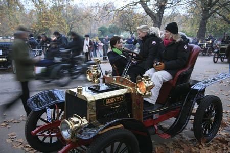 london to brighton veteran car run: London, UK - November 07, 2010: London to Brighton Veteran Car Run participants, Darracq, 1904, have interview before leaving Hyde Park, the event starts at 7:00am at the Serpentine Road in Hyde Park.