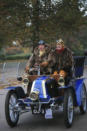 london to brighton veteran car run: London, UK - November 07, 2010: London to Brighton Veteran Car Run participants, Renault, 1902,  leaving Hyde Park, the event starts at 7:00am at the Serpentine Road in Hyde Park.