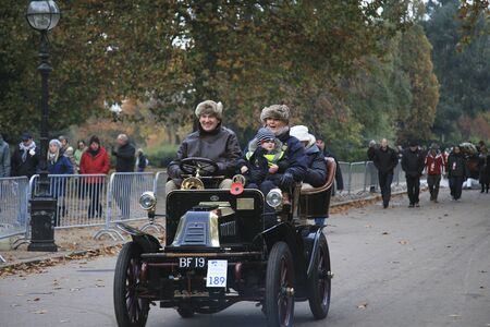 London, UK - November 07, 2010: London to Brighton Veteran Car Run participants, De Dion Bouton, 1902,  leaving Hyde Park, the event starts at 7:00am at the Serpentine Road in Hyde Park.
