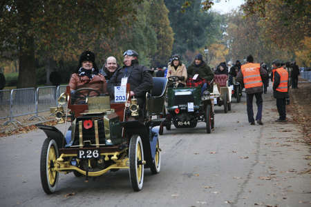 london to brighton veteran car run: London, UK - November 07, 2010: London to Brighton Veteran Car Run participants, Dennis, 1902,  leaving Hyde Park, the event starts at 7:00am at the Serpentine Road in Hyde Park.