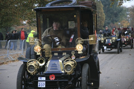 London, UK - November 07, 2010: London to Brighton Veteran Car Run participants, Mors, 1902,  leaving Hyde Park, the event starts at 7:00am at the Serpentine Road in Hyde Park.  Stock Photo - 11988078