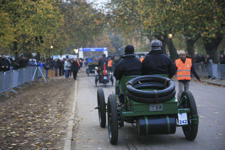 London, UK - November 07, 2010: London to Brighton Veteran Car Run participants, Napier, 1902,  leaving Hyde Park, the event starts at 7:00am at the Serpentine Road in Hyde Park.