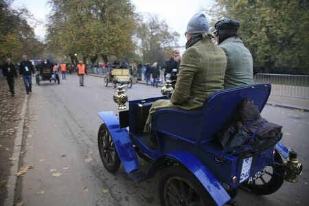 london to brighton veteran car run: London, UK - November 07, 2010: London to Brighton Veteran Car Run participants, Peugeot, 1903,  leaving Hyde Park, the event starts at 7:00am at the Serpentine Road in Hyde Park.