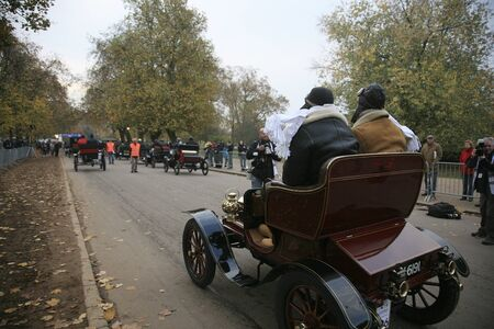 london to brighton veteran car run: London, UK - November 07, 2010: London to Brighton Veteran Car Run participants, De Dion Bouton, 1903,  leaving Hyde Park, the event starts at 7:00am at the Serpentine Road in Hyde Park.  Editorial