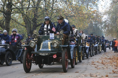 London, UK - November 07, 2010: London to Brighton Veteran Car Run participants leaving Hyde Park, the event starts at 7:00am at the Serpentine Road in Hyde Park.  Stock Photo - 11988065