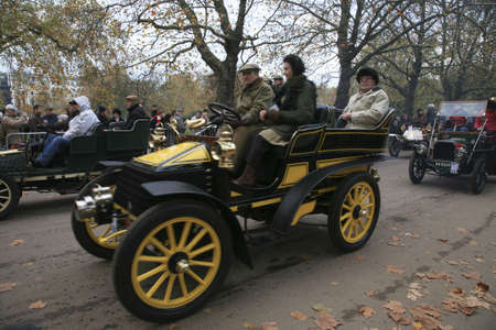 London, UK - November 07, 2010: London to Brighton Veteran Car Run participants, Wolseley, 1903,  leaving Hyde Park, the event starts at 7:00am at the Serpentine Road in Hyde Park.