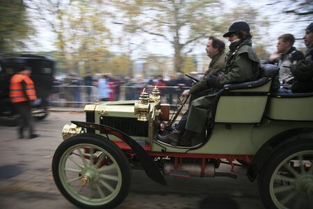 London, UK - November 07, 2010: London to Brighton Veteran Car Run participants leaving Hyde Park, the event starts at 7:00am at the Serpentine Road in Hyde Park.