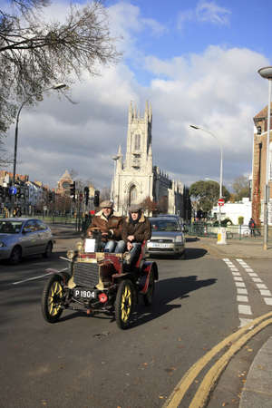 London, UK - November 07, 2010: London to Brighton Veteran Car Run participants, Peugeot, 1904, arriving in Brighton, event starts at 7:00am at the Serpentine Road in Hyde Park, London.