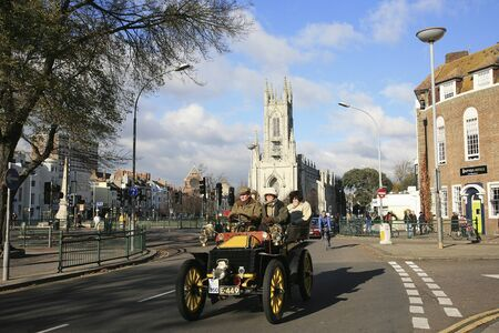 london to brighton veteran car run: London, UK - November 07, 2010: London to Brighton Veteran Car Run participants, Wolsely, 1903, arriving in Brighton, event starts at 7:00am at the Serpentine Road in Hyde Park, London.   Editorial