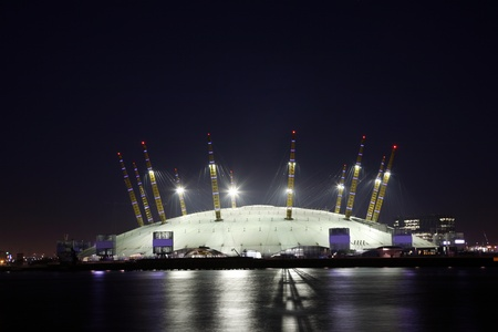 o2: London, UK - January 16, 2012: The Millennium Dome, also called O2 Arena, in the distance across the river Thames. The Dome, completed in 1999 by archetect Richard Rogers, is the largest of its type in the world.