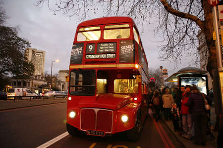 route master bus: London, UK - December 26, 2011:  Heritage Routemaster Bus, operated in London from 1956 to 2005. The open platform allowed minimal boarding time and optimal security      Editorial