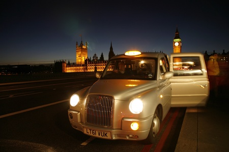 LONDON - December 18, 2011 : A TX4 Hackney Carriage, also called London Taxi or Black Cab, at Westminster Bridge. TX4 is manufactured by the London Taxi Company, LTC
