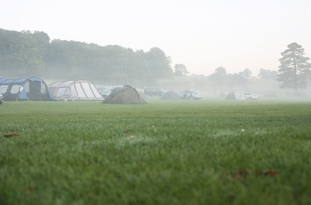 campsite: Tents at a campsite on a foggy morning.   Stock Photo