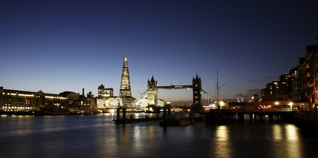 Tower Bridge, in Tower Hamlet,  part of London, at dusk