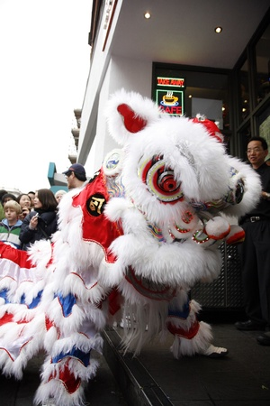 LONDON - January 29, 2012: Performers, lion dance, take part in the celebration of Chinese New Year. Various traditional performance attract thousands of people to the street.