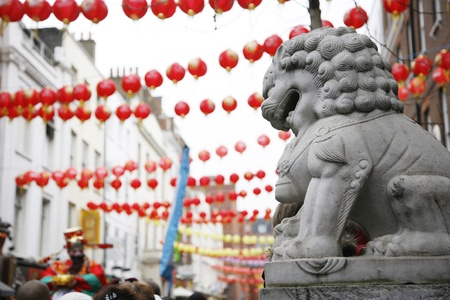 Chinese lion statue and red lanterns on Chinese New Year Stock Photo - 12182572