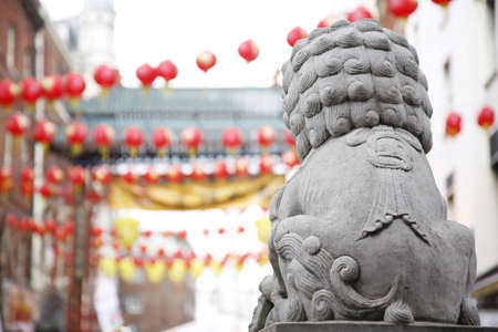 Chinese lion statue and red lanterns on Chinese New Year photo