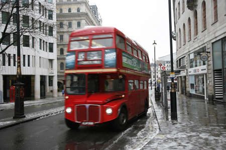 LONDON - February 04, 2012: Heritage Routemaster Bus operated in London from 1956 to 2005. The open platform allowed minimal boarding time and optimal security  Stock Photo - 12256126