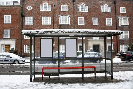 bus stop: The snowy day, empty bus stop in London