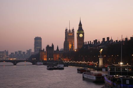 Westminster Palace, Big Ben and Victoria Tower, seen from Hungerford Bridge at Dusk Stock Photo - 12520816