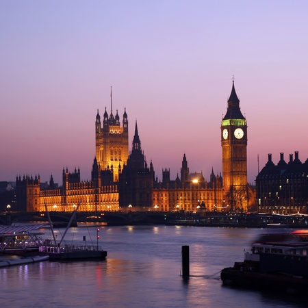 westminster city: Westminster Palace, Big Ben and Victoria Tower, seen from Hungerford Bridge at Dusk Stock Photo