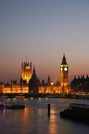 Westminster Palace, Big Ben and Victoria Tower, seen from Hungerford Bridge at Dusk photo
