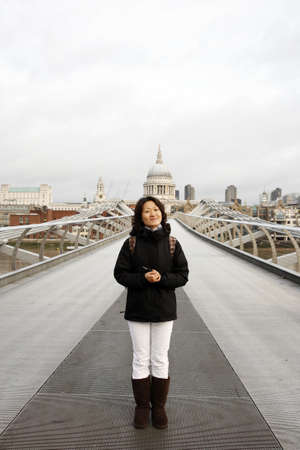 Smiling East Asian Woman at Millennium Bridge, St Paul Stock Photo - 12520122