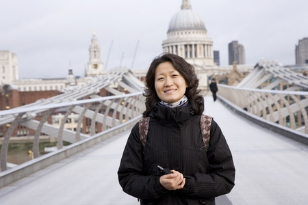 Smiling East Asian Woman at Millennium Bridge, St Paul Stock Photo - 12504652