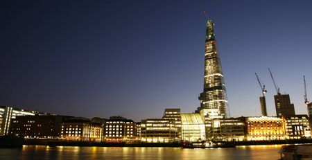 Skyline of City of London seen from south bank of Thames  photo