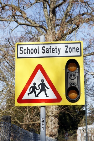 Warning Roadside Sign, School Safety Zone     Stock Photo - 12523979