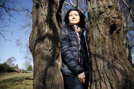 Portrait asian woman, looking off into distance   photo