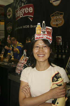 LONDON - AUG 05: Visitors of Great British Beer Festival, 2006, at Earls Court, Britain's biggest beer festival on Aug 05, 2006 in London, UK. Visitors can try wide range of real ales, ciders, perries  Stock Photo - 12445160