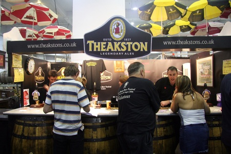 LONDON - AUG 05: Visitors of Great British Beer Festival, 2006, at Earls Court, Britain's biggest beer festival on Aug 05, 2006 in London, UK. Visitors can try wide range of real ales, ciders, perries  Stock Photo - 12445165