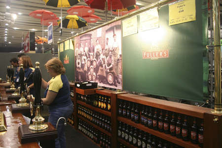 campaign for real ale: London, UK - August 05, 2006: Brewers of The Great British Beer Festival, 2006, at Earls Court, Britains biggest beer festival. Visitors can try wide range of real ales, ciders, perries and international beers.   Editorial