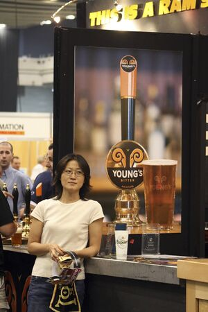 LONDON - AUG 05: Visitors of Great British Beer Festival, 2006, at Earls Court, Britain's biggest beer festival on Aug 05, 2006 in London, UK. Visitors can try wide range of real ales, ciders, perries  Stock Photo - 12445170