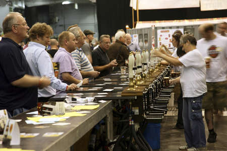 London, UK - August 04, 2010: Visitors of The Great British Beer Festival, 2010, at Earls Court, Britain's biggest beer festival. Visitors can try wide range of real ales, ciders, perries and international beers.