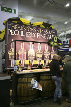 London, UK - August 04, 2010: Visitors of The Great British Beer Festival, 2010, at Earls Court, Britain's biggest beer festival. Visitors can try wide range of real ales, ciders, perries and international beers.    Stock Photo - 12445132