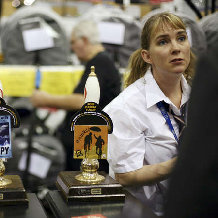 London, UK - August 04, 2010: Brewers of The Great British Beer Festival, 2010, at Earls Court, Britain's biggest beer festival. Visitors can try wide range of real ales, ciders, perries and international beers.     Stock Photo - 12445167