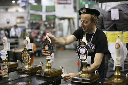 camra: London, UK - August 04, 2010: Brewers of The Great British Beer Festival, 2010, at Earls Court, Britains biggest beer festival. Visitors can try wide range of real ales, ciders, perries and international beers.