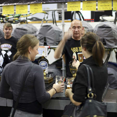 London, UK - August 04, 2010: Visitors of The Great British Beer Festival, 2010, at Earls Court, Britain's biggest beer festival. Visitors can try wide range of real ales, ciders, perries and international beers.    Stock Photo - 12445168