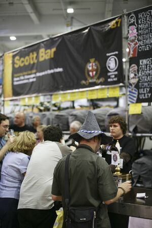 London, UK - August 04, 2010: Visitors of The Great British Beer Festival, 2010, at Earls Court, Britain's biggest beer festival. Visitors can try wide range of real ales, ciders, perries and international beers.    Stock Photo - 12445128