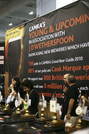 earls court: London, UK - August 04, 2010: Brewers of The Great British Beer Festival, 2010, at Earls Court, Britains biggest beer festival. Visitors can try wide range of real ales, ciders, perries and international beers.