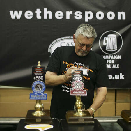 London, UK - August 04, 2010: Brewers of The Great British Beer Festival, 2010, at Earls Court, Britain's biggest beer festival. Visitors can try wide range of real ales, ciders, perries and international beers.     Stock Photo - 12445163