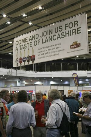 campaign for real ale: London, UK - August 04, 2010: Visitors of The Great British Beer Festival, 2010, at Earls Court, Britains biggest beer festival. Visitors can try wide range of real ales, ciders, perries and international beers.