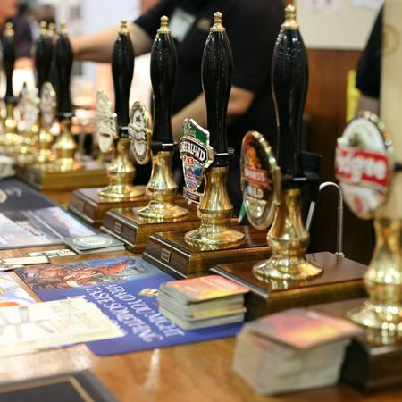 campaign for real ale: London, UK - August 04, 2010: Beer draft tap in the Great British Beer Festival, 2010, at Earls Court, Britains biggest beer festival. Visitors can try wide range of real ales, ciders, perries and international beers.
