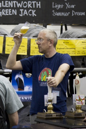 London, UK - August 04, 2010: Brewers of The Great British Beer Festival, 2010, at Earls Court, Britain's biggest beer festival. Visitors can try wide range of real ales, ciders, perries and international beers.     Stock Photo - 12445156