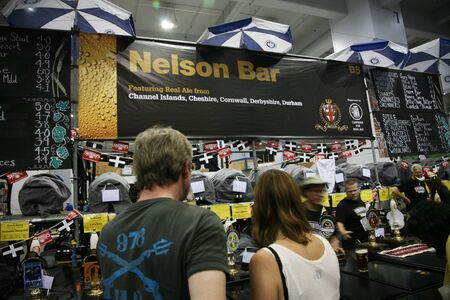 campaign for real ale: London, UK - August 05, 2010: Visitors of The Great British Beer Festival, 2010, at Earls Court, Britains biggest beer festival. Visitors can try wide range of real ales, ciders, perries and international beers.  Editorial
