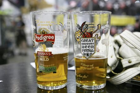 campaign for real ale: London, UK - August 05, 2010: The Great British Beer Festival, 2010, at Earls Court, Britains biggest beer festival. Visitors can try wide range of real ales, ciders, perries and international beers.