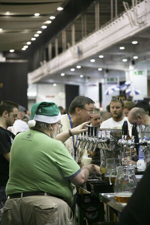 campaign for real ale: London, UK - August 05, 2010: Brewers of The Great British Beer Festival, 2010, at Earls Court, Britains biggest beer festival. Visitors can try wide range of real ales, ciders, perries and international beers.